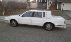 Project Car or Parts Car; needs new transmission, and more; Beautiful blue veleteen interior and white exterior. Nice ride when running, has studded tires, very little body damage. New windshield. Call 1--- or 1--- for appointment.