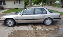 1991 Honda Accord. Somebody damage passenger side. Heater and AC works sometimes. Check engine light is on. Car runs good. 28 miles to the gallon.
