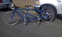 """I'm selling my Blue 1993 Burley Duet Road Tandem (Bicycle Built for two). This bike has only been ridden approximately 15 times or so. The rubber hairs or """"sprues"""" -- bits of rubber that went into the vent holes in the tire mold are still on the tires. It"""