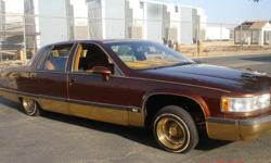1993 Cadillac lowrider for sale, asking $5,000 OBO for it, car runs good, brown with patterns on the roof, and murals on the quarter panels, really nice two tone interior, for more information on this car just contact the number that is given any time of