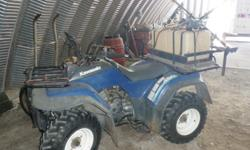 1993 Kawasa all teraine ATV, is equiped with a sprayer, and a trailer. Located in Mohall. Please call -- if interested.