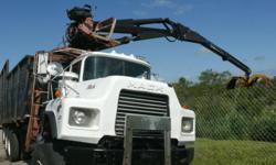 1993 Mack Grapple Truck. Model DM 690 S. Great heavy duty work truck. Call Tony 772 519-0060