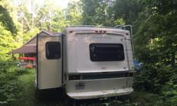 For sale is our 5th wheel. -the slide recently went beyond it's boundary resulting in a small crack near the floor. The slide out wall needs patching. -the awning is beginning to peel in one portion, other than that, it is in good condition. The