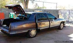 """1995"" Cadillac Great condition Runs great Leather interior No dents Clean luxury Metalic purple A must have AC/ Heater run great This Car is a Beauty Asking $2,700 Call 520-551-0019"
