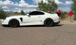 1995 TOYOTA SUPRA TURBO. THE CAR IS AN ORIGINAL 6 SPEED CAR BUT HAS BEEN CONVERTED TO AN AUTO. THIS CAR WAS BUILT FOR FUN BUT ALSO VERY SAFE EVERYDAY DRIVING TO THE DRAG STRIP AND OCCASIONAL ROLL RACE ON THE WEEKEND.. NO EXPENSE WAS SPARED IN THE BUILD OF