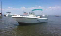 """1995 Wahoo 2100 EFS center console sport fishing boat Deep V Hull 8'-0"""" Beam Foam filled hull similar to Boston Whaler (Wahoo was a spin off company from Boston whaler) Currently docked at a Marina on the south shore. I have copies of all service"""