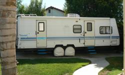 Trailer is in good to very good condition, awnings on all windows and main awning is almost full lenght of trailer. New refer, newer water heater and upgraded to direct spark ignition. Mid galley with front living and couch slide with slide awning. AC fan