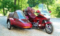 1996 Honda Gold Wing 1500 SE motorcycle with Champion Side Car. Only 37,075 miles. Champion Side Car - 2+2. Toneau cover. Convertible top with side curtains. Tilt front for easy entry. Brakes. Lights. Baggage compartment in rear. Seatbelt. Matching paint