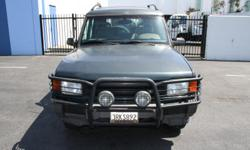 1996 Land Rover LR3 in good working condition for sale. The car has a green exterior with tan cloth interior and has an upgraded stereo system. The car has some age and character but perfect for a learner car or someone who needs an SUV as a spare! Email