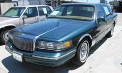 1996 LINCOLN TOWNCAR VIN: 1LNLM81W0TY627317 4.6 LITER V8 AUTOMATIC REAR WHEEL DRIVE EQUIPMENT LEATHER, AIR CONDITIONING, POWER WINDOWS, POWER LOCKS, TILT WHEEL, CRUISE CONTROL, AMFM STEREO, CASSETTE, DUAL POWER SEATS, ALLOY WHEELS, DUAL AIR BAGS, POWER