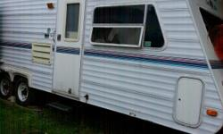Beautiful inside and out,26 ft travel trailer,no leaks, new wood floor, back bedroom with queen bed and queen bed up at front also, very bright with lots of windows, nice large washroom/shower, good size kitchen/double sink, big fridge/freezer,large