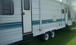 I am selling for a friend a 1997 Conquest by Gulf Stream 32 ft. Long With A 12X4 Ft Tiptout. This is in very good condition, It has a queen size bed in bedroom, sofa bed in living room , can sleep 6-10. It has a Power Tongue Jack, Roof Air Condition works