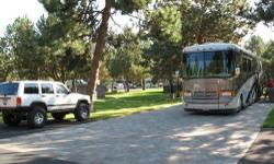 Luxury bus has Spartan K2 chassis with 400 hp w/air ride suspension. Featuring large slide out, central duo-therm basement air conditioner, Aqua hot heating system, satellite dish, corian countertops, ceramic tile in kitchen and bath, large shower and