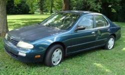 4dr, blue with tan interior, new battery, AC, power windows, CD/radio, 156,700 miles.