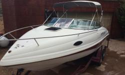 1997 Rinker Festiva 21 Foot Boat with 1997 Master Craft Trailer; Trailer has two axles; Engine is a 5.7 Liter Mercruiser Inboard/Outboard; Depth Finder; Swim Step with fold down Steps; New Bimini Top; custom snap on cover for storing or towing; additional