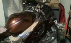 1997 Suzuki Gsxr 750 Chrome and Candy paint full D&D system clean bike paint jobs is great ..... Salvage title bike must go ASAP..... This bike has been jetted and runs great needs a rider