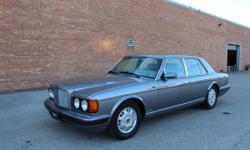 1998 BENTLEY BROOKLANDS THIS CAR IS READY TO GO STRAIGHT TO ANY JUDGING FIELD IT HAS GREAT COLOR CONBINATION (A BLUE/SILVER METALLIC PAINT WITH GRAY LEATHER INSIDE THE CARPET IS PERFECT THE LEATHER IS PERFECT THE INTERIOR WOOD IS NOT CLOUDY OR CRACKED NEW