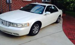 It's pearl white sunroof Crome cadillac rims 4 door leather seats it's loaded
