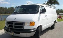 This is a 1998 Dodge Ram Cargo Van. This van has 2 front seats with a computer stand in between them and a cargo area separated by bulkhead. The van has an automatic transmission, AM/FM audio and air conditioning. This van has shelving and drawers in the