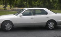 Pearl White 1998 Lexus LS 400. 8 Cylinder engine with automatic transmission. Features include: New A/C, cruise control, satellite stereo hookup, console, clock, trip odometer, center arm rest, full size spare tire, front/rear floor mats, heated seats,