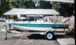 1998 predator 17 ft .70hp Johnson .12 volt motorguide trolling motor .full.helm full boat cover .lots storage . rod holders .galvanized trailer . new tires. This is a 1# owner boat very well kept and maintened .has been fully serviced and lake ready .just