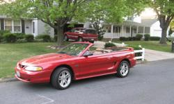 1998 Red Mustang GTConvertible 2D; Excellent Condition, Tan Leather Seats, Automatic, CC, Pwr St, AM/FM/CD, 115,000 mi....drives like a dream on the road & in the city