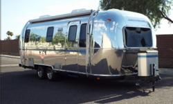 """Airstream was purchased in 1999 new.The """"Safari"""" model has full solid oak interior in immaculate condition.Text (608) 218-3202"""