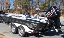 Garage kept, 1999 Bass Cat for sale. This boat comes with a Mercury 225 Optimax motor with a four blade stainless Mercury propeller, Motor Guide Tour digital 82lbs thrust trolling motor, Lowrance electronics, removable flipping deck, plenty of storage