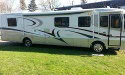 1999 Holiday Rambler Endeavor with 275hp Cummins Diesel Connected to an Allison 6 Speed Automatic Transmission. Run and drives like new, with only 36,000 miles it should. Also has a 7500KW Onan Generator with only 175 hours. The Interior and Exterior have