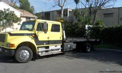 1999 international 4700 flatbed ,clean title,rebuilt engine from dealer with paper work,%80 tire 2 car huler call 912-354-7521 george