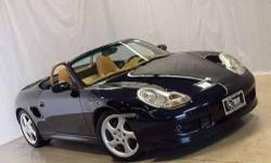 This car has a very unique trim with leather, wood, and stainless steel, rear wing, factory xenon headlights, the center console matching the exterior dark blue metallic etc etc. You will not find another Boxster like this. The car is loaded with