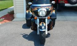 Motorcycle is in excellent shape sporting a custom paint job. The bike has been garage kept and has only 28,650 miles. The trike has been very well maintained.