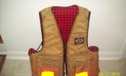 Adult Life Jacket is also a fishing vest. Only used a couple of times. It is in Excellent Condition and ready to use. Chest Size 50-52 inches *** Adult XX-Large*** Safety reflectors have been added to this vest Vest has 2 deep front pockets with velcro