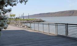 The Best of Both Worlds WATERFRONT Condo / QUICK Manhattan Commute (1) bedroom / (1) bath / 1,099 square feet Updated Kitchen has Stainless Steel Appliances, Granite Counter Tops, Tiled Backsplash w. Accents Updated Bathroom has Glass Mosaic Tiled