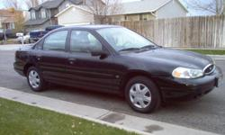 2000 Ford Contour SE. Nice clean car! Low Miles only 117k... The car gets realy good gas mileage, 4 cylinder engine with automatic transmission. Brand New Tires, power windows, power doors! Clean inside and out, drives realy nice its a comfortable car.