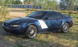 This 2000 Ford Mustang Standard,V6 . Very well maintained vehicle, changed oil with synthetic oil every 2,500 miles and there has only been 2 owners in it's lifetime including myself. It has a custom paint job, 20'' BSA chrome rims with low profile tires