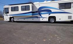 2000 Foretravel 40' Unicoach U320 with large driver side slide. Original MSRP $465,000. 106,373 Miles Chassis Features: Foretravel monocoque chassis and superstructure, Cummins ISM-450 hp electronic diesel engine, Allison HD-4060R 6 speed transmission