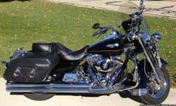 Black and chrome classic cruiser with many upgrades. All maintenance records available. Engine: 1550 CC - Big bore kit with cams and K&N breather kit. Vance and Hine true dual 2 inch long shot drag pipes. Driver backrest, original