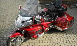 For sale 2000 Honda Goldwing GL 1500 SE Ultimate 25th Anniversary edition. Very nice good condition bike. This is Roadsmith Ultimate Trike Conversion. Independent rear suspenion, raked front end for EZ steering, reverse. Very nice two tone red color. CB