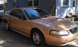 I have a 2000 v6 automatic gold mustang for sale. The body is in good shape, the inside is in good shape also it has a minor rip on drivers side seat can be covered with seat covers and a minor dent on the rear end of the car. this is a sporty looking car