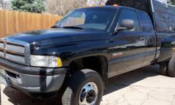 1 ton dually, 4x4, 5.9 Cummins diesel, 5 speed manual transmission, 4.10 limited slip rear end, Laramie SLT extended cab, leather, power windows/seats, AM/FM cassette CD, hidden goose neck and class 5 bumper hitches, new injector, vacuum and water pumps,