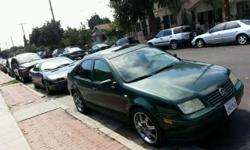 Forest green four door 2000 VW Jetta 150milles 18 inch chrom rims with low profile tires. Fair condition every thing works power every thing and tan leather interior. Runs great. Asking $2,500.00 OBO. Call me Eddie se abla español () -...