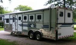 """4 Star 4 Horse LQ Like New you must see to believe! WERM floor, air ride, 8ft. wide, 7""""6 high. Hydraulic jack, enclosed battery compartment , 2- 30# propane tanks. Full drop down windows with removable screens. One - step awnings on both sides of trailer"""