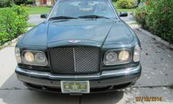 Executive is sacrificinghis showroom condition 2001 Bentley Arnage with only 22,616 miles. This model boasts the Rolls Royce  6.75 Litre engine, dual air, pop-up navigation, and dual dvd's provide added comfort to this prestigious