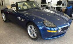 2001 BMW Z8 Roadster is in a very rare color combination of Topaz Blue Metallic with Soft Leather Crema/Black leather interior. There were only 178 Topaz Blue Metallic Z8's made in 2001. The Z8 is in excellent mechanical & cosmetic condition.