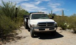 2001 Dodge 3500 1 ton diesel flatbed with toolboxes and tommy lift gate 79000 miles