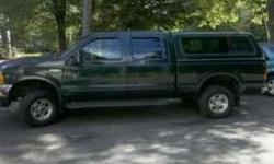 2001 F250 Lariat Crew Cab. Dark Green with tan Leather power everything (windows/mirrors/seats),heated seats,6 disc cd,Michelin tires Truck has new exhaust manifolds studs/nuts ($2000),New shocks ($150),New Starter ($150),Brake lines have been replaced
