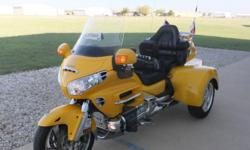 THE BIKE ITSELF IS A VERY NICE 2001 HONDA GOLDWING GL1800 WITH 66,776 MILES. IT IS HOT ROD YELLOW IN COLOR AND LOOKS BEAUTIFUL! IT HAS ALL OF THE GOLDWING MODEL OPTIONS INCLUDING REVERSE, AM/FM RADIO, DRIVER-TO-PASSENGER INTERCOM SYSTEM,