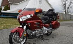 Beautiful, nearly perfect condition 2001 Honda Goldwing in original deep wine red color. Low, low 28K miles on this jewel of the touring world, so you're getting a nearly new condition bike for about 1/3rd the price. AM/FM radio, intercom, auxiliary
