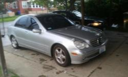 I'm selling a 2001 Mercedes-benz, four door. Silver exterior, black leather interior. Automatic, all power. Tinted windows. The car works perfect. Never had problems with it. Just had the full engine tune up. Runs smooth and quiet. Strong engine. Call or